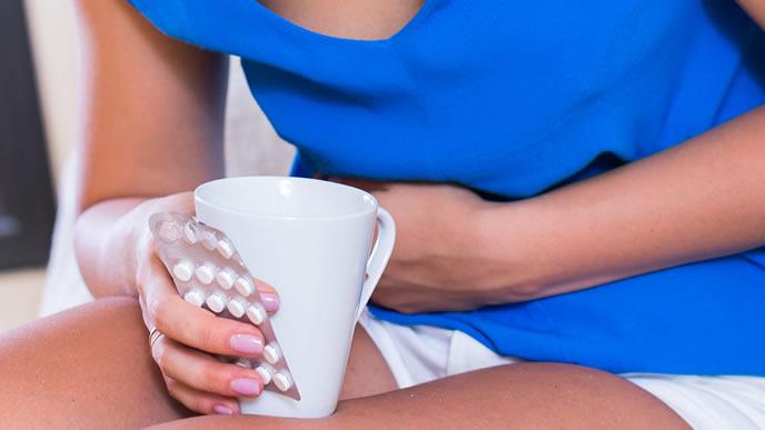 妊娠初期でつわりに苦しむ女性