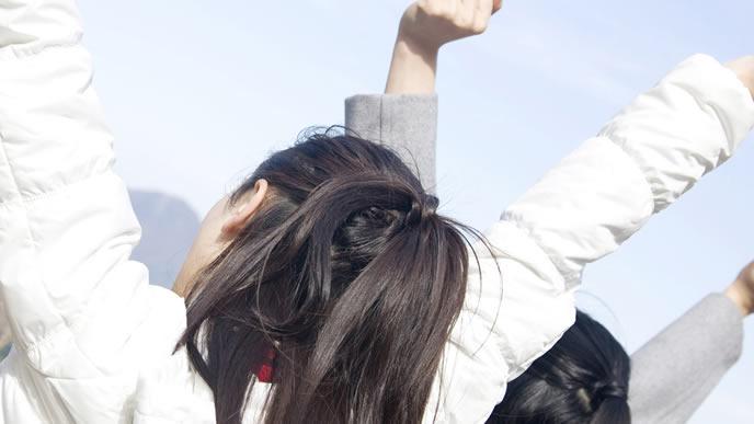 産休が終わり仕事への気合を入れる女性