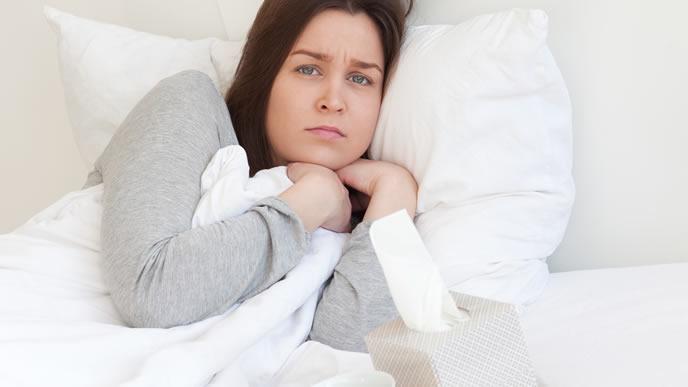 つわりで寝不足になっている妊婦