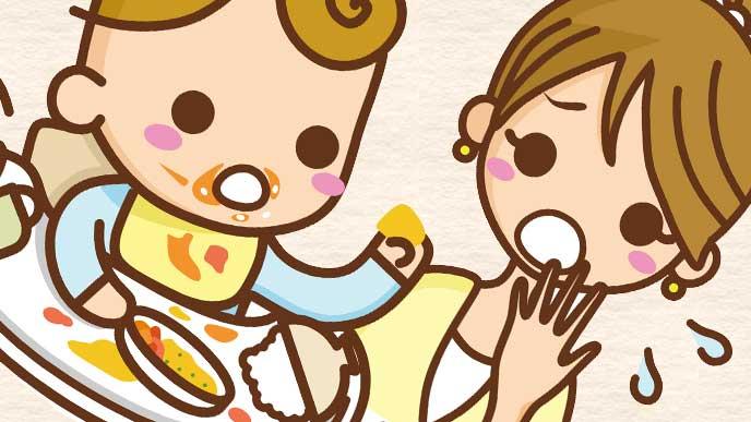 離乳食を手で掴んで遊びだした赤ちゃんを見て焦ってるママのイラスト