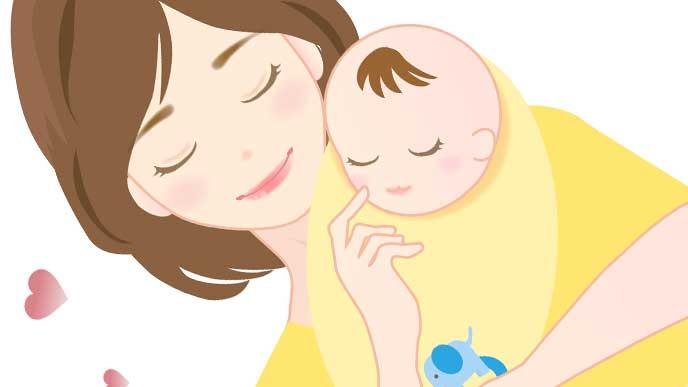 おくるみをしてママに抱っこさながら寝ている赤ちゃん