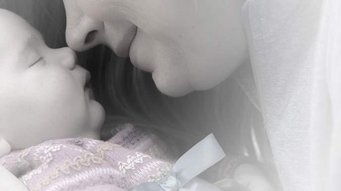 母親が赤ちゃんの鼻に自分の鼻を押し付ける