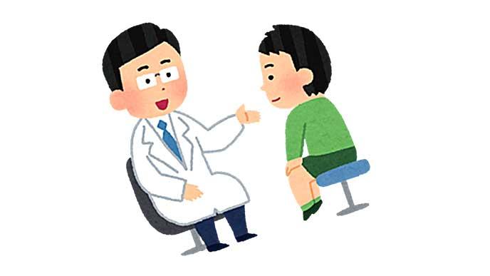小児科で診断を受ける男の子のイラスト
