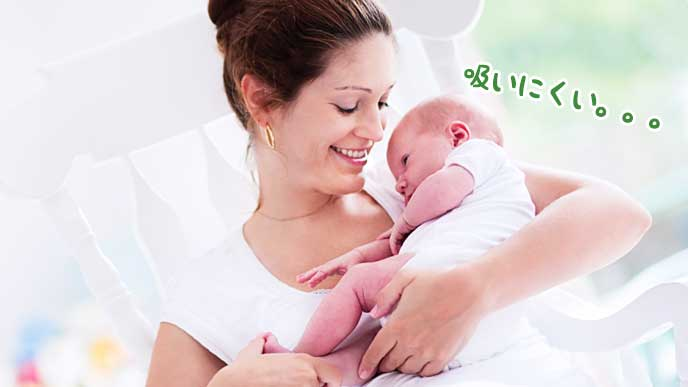 笑顔で赤ちゃんに母乳を与えようとしているお母さん