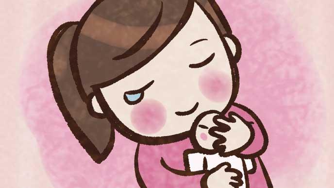 赤ちゃんを抱きながら感動で涙がこぼれてる母親のイラスト