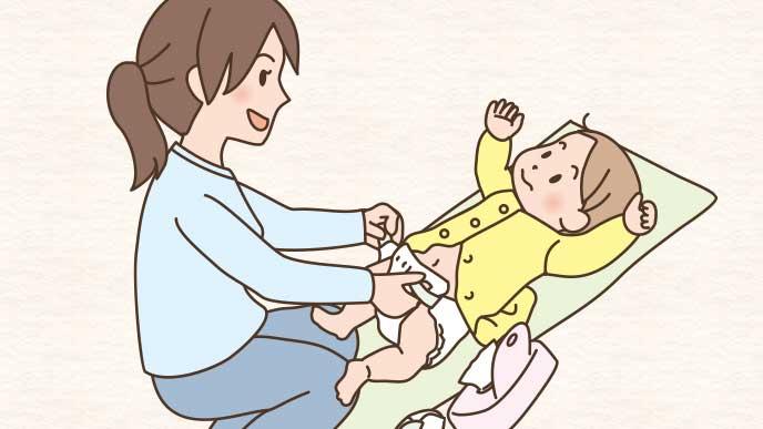 赤ちゃんのおむつ交換をしてる母親