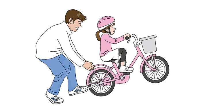 娘に自転車を教える父親